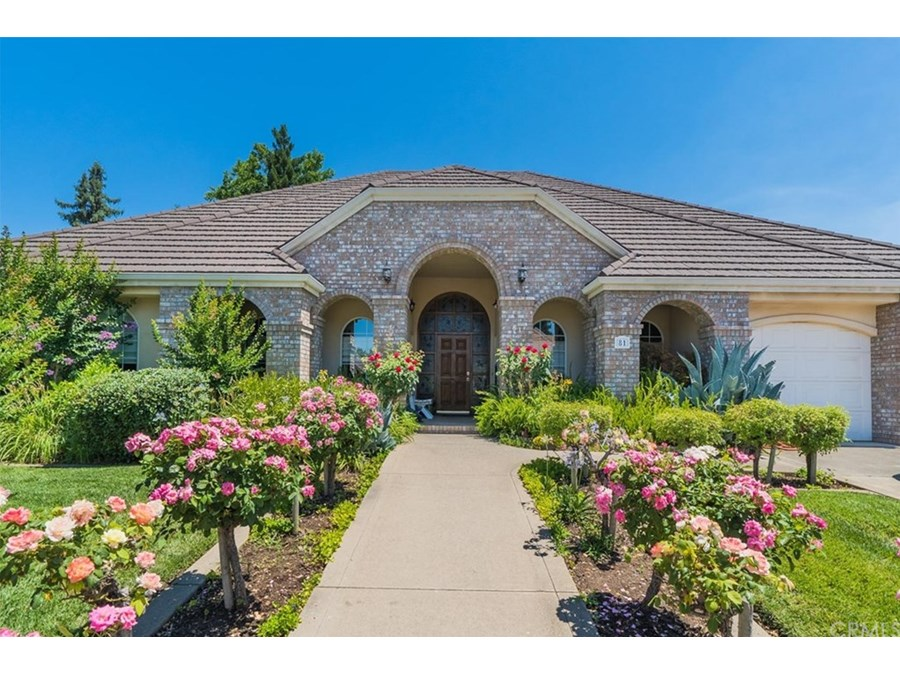Rose lined entry welcomes you into this beautiful home!