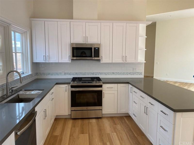 Kitchen Features Quartz counters, stainless steel appliances and a subway tile backsplash.