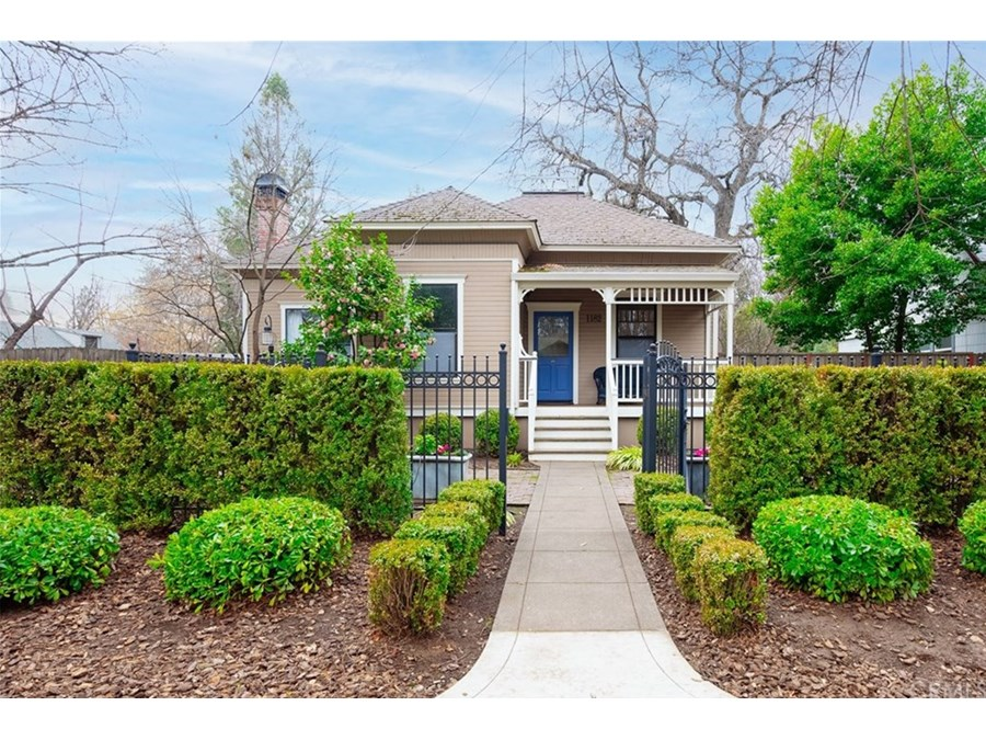 Stunning Chico Charmer with pristine gardens and custom wrought iron fence and gates.