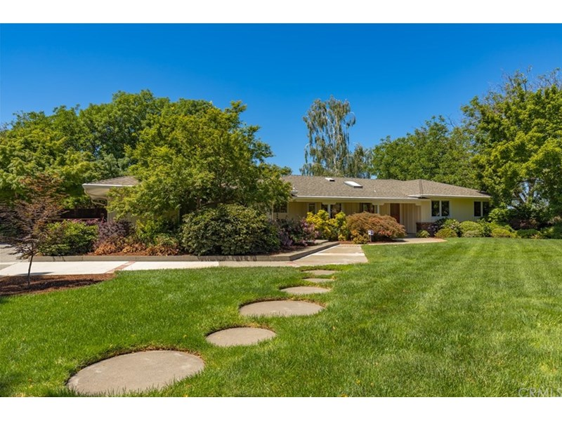 This wonderful country property sits back from the road. Full mature landscaping front and back.