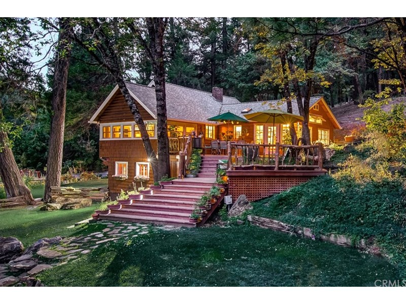 Unique riverfront 5 acre retreat with unrivaled privacy and natural beauty.