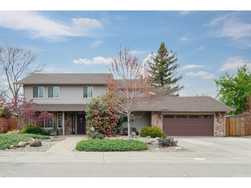 Stunning home with beautiful low maintenance landscaping.