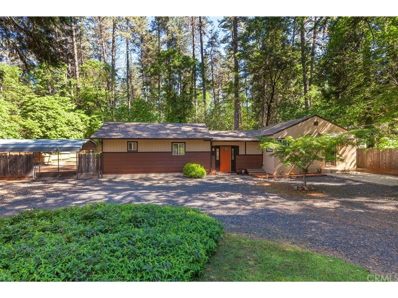 Stunning setting nestled in the trees, with ample parking for Cars, Boats, RV, etc. .