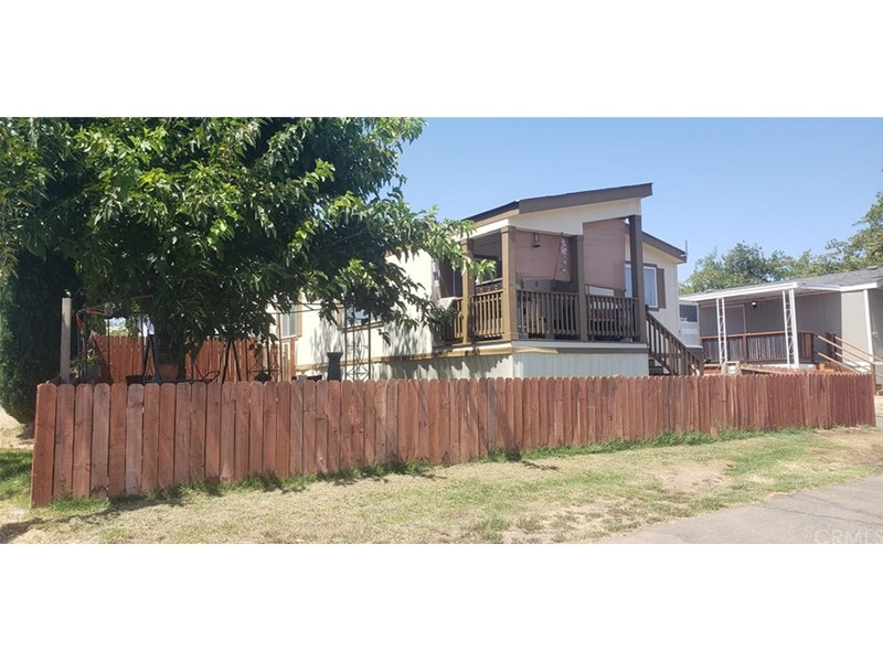 Large, fenced-in yard surrounding a very upgraded Manufactured Home on three sides located on the outer edge of this park with the scenic views of Rolling Hills and the Mountains.