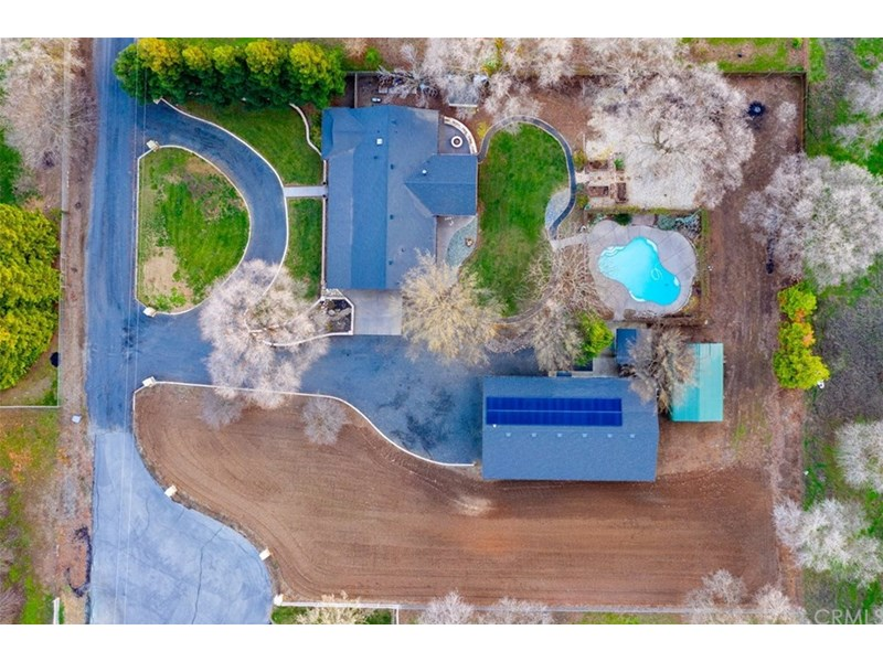 Fantastic overhead shot of the 1.5 acres, 36X60 shop, OWNED solar, pool, circular driveway, lush lawns, shade trees PLENTY of undeveloped space to create your own slice of heaven!!