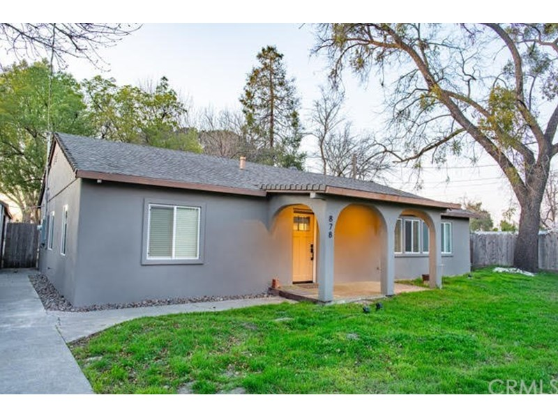 Exterior of home made of insulated Cinder Block covered with newer stucco for Great Insulation, Energy Efficiency and sturdiness. Located on 1.42 acre lot with lots of room to build on the North Chico Area Greenbelt.