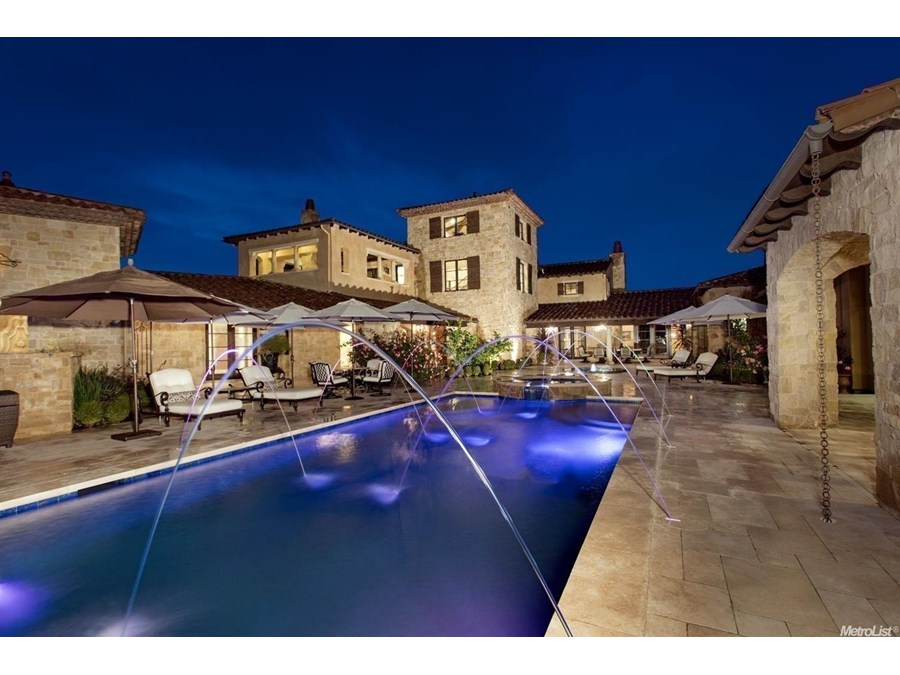 Located within the rolling hills of the 24-hour gated exclusive custom area of Serrano Country Club is a masterfully crafted 9500+ sq ft estate reminiscent of Tuscany and Provence set on an exceptional two-acre parcel. Designed for the ultimate in resort style living, the salt water pool and spa water features also include multi-phased lighting which is all separately controllable.