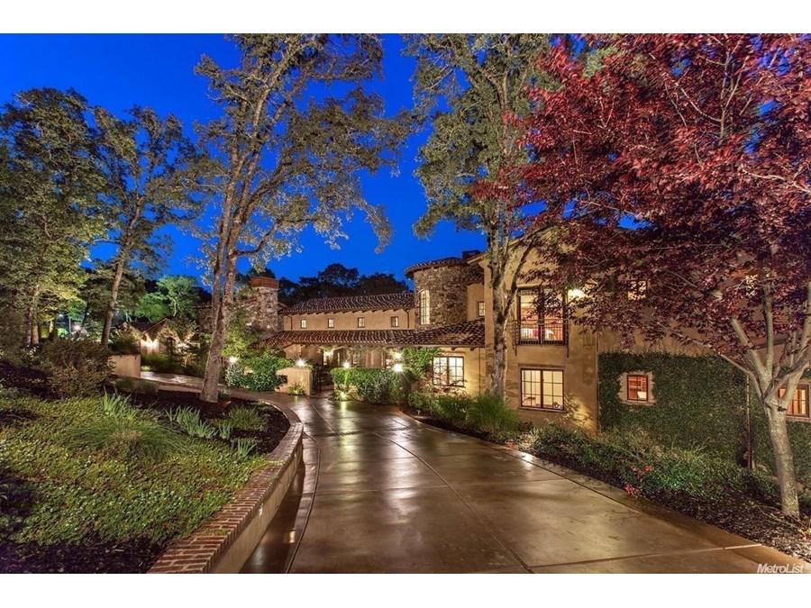 The warmth and charm of Spanish architecture graces this stunning guard-gated Serrano Country Club estate featuring the finest in craftsmanship and design.