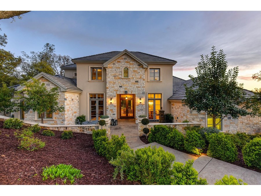 Gorgeous Custom Built Wichert Home behind the gates in Serrano features OWNED SOLAR.