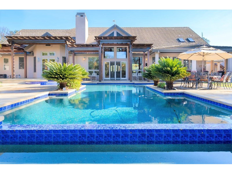 "Welcome home to country living in Granite Bay at its best! Lovingly referred to as, ""The Ranch"" no expanse was spared to improve on this superb property featuring a resort style backyard living. Infinity edge pool recently refinished with Pebble Tec style surface, Baja entry, separate spa, newer pool equipment, extensive patio extends to second wave pool &amp 4000 Sq Ft indoor Basketball court, gym, lounge &amp full bath.  Custom designed Red Wood Pergola's have been outfitted with remote controlled Phantom screens. Covered sitting area with BBQ Island, rock fireplace, stamped concrete offers easy access to kitchen &amp front covered patio. Dave Bushnell's landscape designs are apparent from the front gate to beyond the pool &amp secluded back yard views."